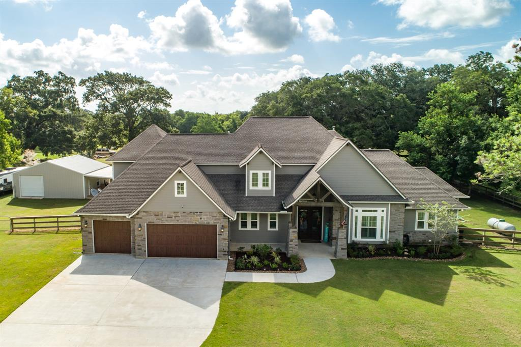 THIS IS THE ONE YOU HAVE BEEN WAITING FOR. UNBELIEVABLE HOME, CUSTOM BUILT BY BALLARD BUILDERS.  ENJOY WATCHING THE DEER ON A BEAUTIFUL 5 ACRE LOT FULL OF MAJESTIC OAK TREES. NO DETAIL HAS BEEN OVERLOOKED. BEAUTIFUL WOOD LOOK TILE FLOORS THROUGHOUT THE ENTIRE FIRST FLOOR INCLUDING MASTER BEDROOM, 2 SECONDARY BEDROOMS, A STUDY, & HALF BATH.  UPSTAIRS HAS A GREAT GUEST BEDROOM AND LARGE GAME ROOM W/BEAUTIFUL BUILT IN CABINETS. YOU CAN'T MISS THE MASSIVE VAULTED CEILING IN THE GREAT ROOM OR THE STUNNING STONE FIREPLACE. THE KITCHEN IS A CHEF'S DREAM; HUGE ISLAND W/PLENTY OF SEATING, AMAZING CUSTOM CABINETS, COMMERCIAL GRADE APPLIANCES INCLUDING 6 BURNER RANGE & DOUBLE OVENS, A POT FILLER, & STAINLESS FARM HOUSE SINK.  THE MASTER SUITE IS OUT OF A MAGAZINE; FRENCH DOORS LEADING TO BACK PATIO & AN AWESOME WALK IN CLOSET. MASTER BATH FEATURES HIS & HER VANITIES AND AMAZING CLAW FOOT TUB. OUTSIDE IS THE REAL DREAM WITH RESORT STYLE POOL, OUTDOOR KITCHEN, AND GREAT SHOP WITH LARGE LEAN TO.