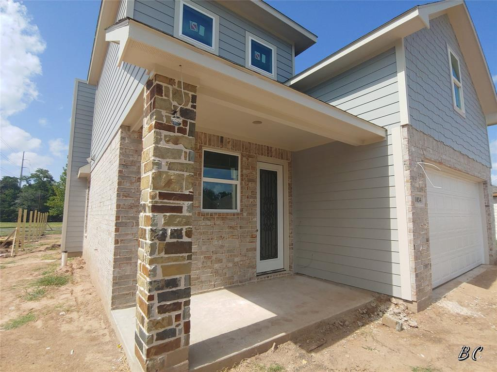 NEW CONSTRUCTION HOME in the small town charm of East Bernard. 40 minutes west of Houston! This custom built home is 3 bedrooms with 2 full baths and 2 half baths. High Ceilings with a large foyer and open concept plan! Home features natural stone counter tops in kitchen, baths and utility area. Kitchen Island with walk-in pantry! Indoor/Outdoor LED lighting, tankless water heater, hardwood framed window casings and excellent craftsmanship! Zoned to the award winning East Bernard ISD!