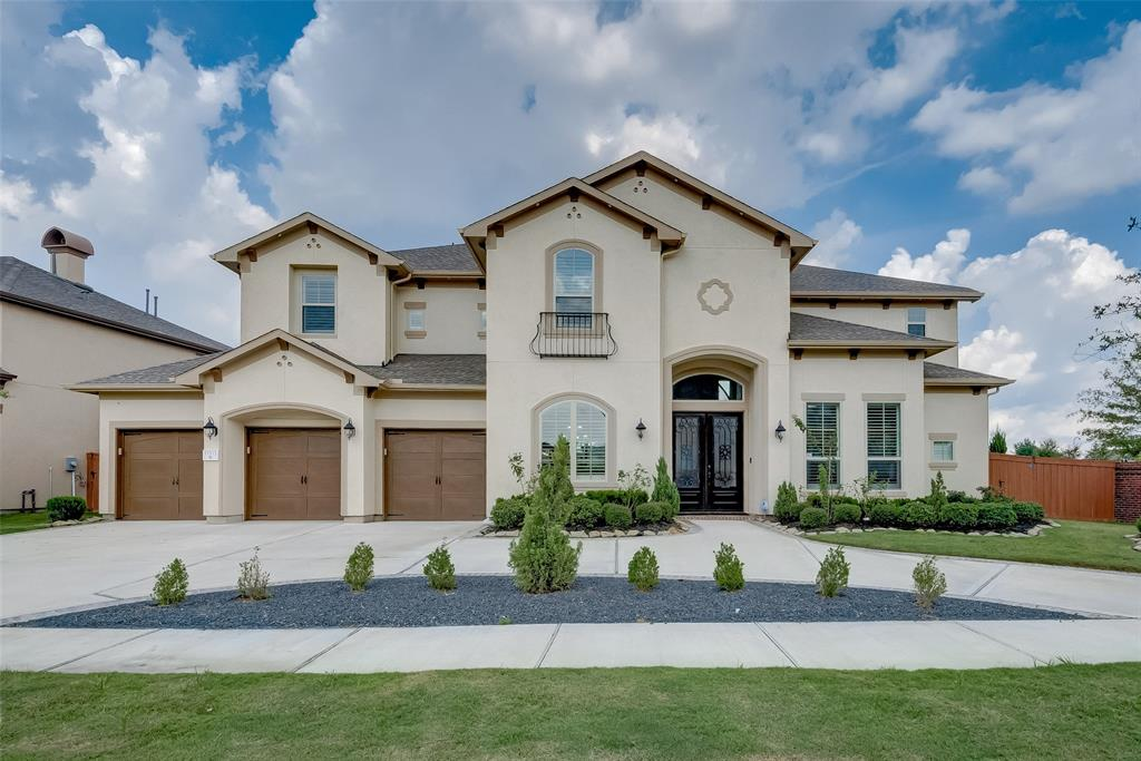 This Stucco elevation home is the epitome of luxury! Circular driveway and corner lot location will impress you from the moment you drive here. Two grand master bedrooms and 2 bedrooms down is a rare find in this prestigious community of Aliana zoned to Austin High School.. 8 ft double door opens to a dramatic foyer. High ceiling study with French doors, large arch-shaped windows in contemporary formal dining at the entry and wide spiral staircase are breathtaking. You can't resist the beautiful high ceiling and wine room. This chefs favorite kitchen has a large island with custom dual compartment sinks and tons of other upgrades. Contemporary chandeliers, shutters on all windows, brick wall fence at back, Texas-size large walking closets are few of the many upgrades. You will love sipping your morning coffee in Balcony over the extended cover patio. Large outdoor kitchen and 4 car garage is a cherry on top. Don't miss the chance to own this Luxury Masterpiece. Upgrades List attached