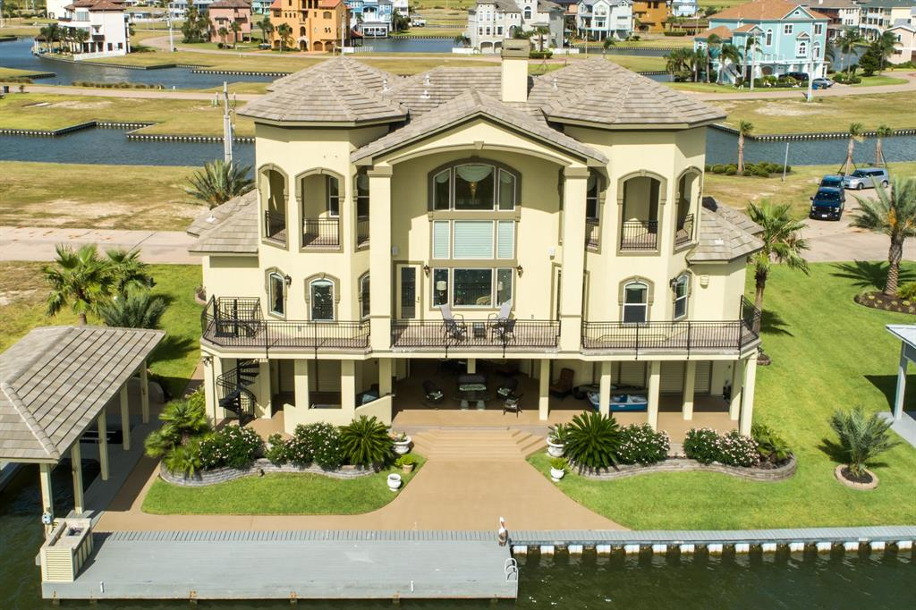 Exquisitely appointed Harborwalk canal front home. Home is located on a 75' wide canal with 112' of canal frontage & 1,000 yards from the bay. Outdoor amenities include 35' boathouse w/ separate jet ski berth & lift, 40'x8' dock, mega-watt fish light, fish cleaning station, beautiful landscaping, corrosion proof garages with storage cabinets + work area, customized golf cart, outdoor kitchen & large patio area. Inside amenities: elevator, ¾ house generator, tankless water heaters, water softener, large niches, exquisite trim molding & hand rails throughout, oversized pantry, whirlpool spa & tub, marble fireplaces, pool table, granite countertops, Murphy beds, custom drapes & blinds, travertine flooring, ceiling fans & HD TV's in most rooms. Foam insulated with epoxied drives, sidewalks & garage spaces. Custom concrete tiled roof, with windstorm approved windows & doors. Large full view windows facing south for scenic bay views. Home was built in 2010 and has been carefully maintained.