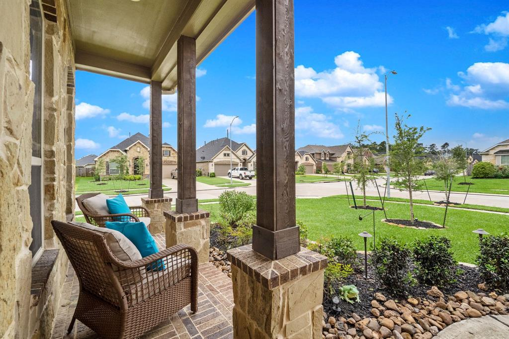 """Gorgeous Like New Lennar Home in Master-planned Community - Falls at Imperial Oaks. Nearby Resort Type Pools, Park, Playgrounds, Ponds, Dog Park, Fitness Center, Private Clubhouse, and Tennis Courts. YMCA to be Built Soon, Lake Holcomb & Nature Trails in Subdivision. Award Winning Schools in Conroe ISD Zoned to Grand Oaks High School. Just Minutes to The Woodlands Mall, ExxonMobil and Plenty of Fabulous Restaurants. Your Dream Kitchen Awaits with Sparkling Granite Countertops, 42"""" Stained Cabinets, Custom Backsplash, Huge Conversation Island, Breakfast Area and Counter/Cabinet Space Galore! 4 Bedroom (2 Down) 3 Bath Open Concept Floor Plan with Oversized Game Room and Formal Dining. Master Suite Boast Tray Ceilings, Dual Vanities, Garden Tub, Walk-in Shower and Large Closet. Front and Back Covered Patios, Water Sprinkler System and MORE!"""