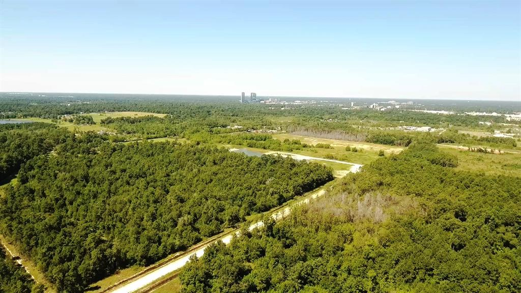 6 to 94 acres of unrestricted land within 2 miles of The Woodlands Mall, Just off I45. Ideal for warehouse, industrial or large acreage residential. Central Water nearby.