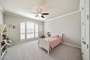 Second bedroom also has crown moulding, plantation shutters, high baseboards and upgraded fan/lighting. Secondary bedrooms in the home are very generous in size and can accommodate multiple pieces, or large pieces of furniture.