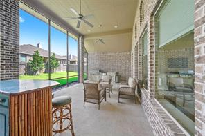 Very large covered rear patio is also wrapped in brick, and has also been screened in! This area can now be enjoyed without all the flying insects. Screens also add a layer of additional privacy when looking from the outside in.