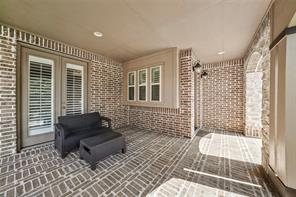 Huge covered front porch with brick flooring is a great place to spend time outdoors, or just keep the rain off while coming and going to and from the house.