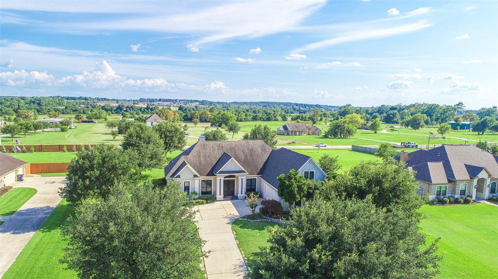 GORGEOUS home on ONE ACRE in Montgomery!? Here you go! This home has it all with a great LOCATION and good elbow room in a lake community with a community boat launch. You will enjoy this estate community in Harbor Side. It's a beautiful place to live and offers quiet and peace while also being close to everything you need. You have the best schools, a security gate, lake access, and good access to HW 105 and the amenities you need on a daily basis. The homes is mostly all on ONE story with the exception of a bonus room upstairs that can be a game room, another bedroom, or anything else you want. You'll love the high ceilings, and all the NEW WINDOWS by Renewal by Anderson let in great natural light throughout the home. This home has a nice open living area that is open to the kitchen and formal dining room. There is a true study that could double as a bedroom if needed, but also the upstairs bonus room that has a full bath for a possible 5 bedrooms. You'll love this home!!!