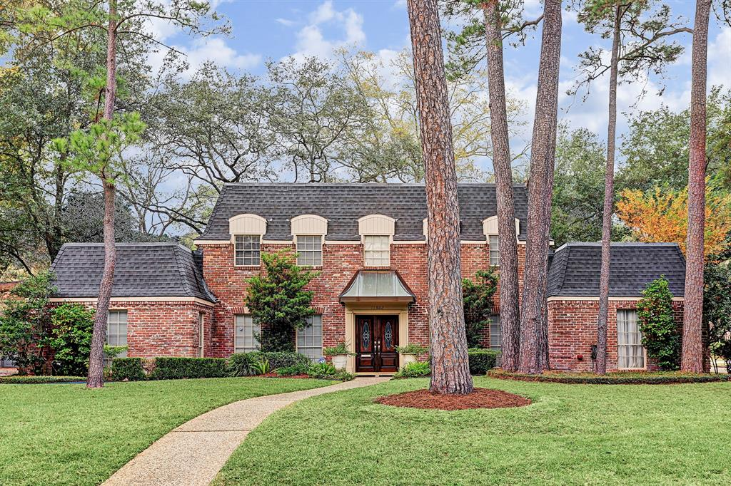 Searching for a larger home in a safe, quiet neighborhood? That NEVER flooded? (per seller) in the SBISD? Near everything, this classic 5/3.5 French Manor House is set high on a superbly located interior corner lot in popular Nottingham. Impressive elevation brimming with architectural elements. Inside, the tile floored gallery extends the full width of the home's two story main section. Impressive dining room features rare, marble-faced fireplace. At opposite end of the gallery are entrances to the family rm and private Master Suite which includes a renovated bath and dual walk-in closets. Comfortable family rm with Country French-style accents leads to charming breakfast area; cook's kitchen, and laundry rm. A graceful stairway concealing a powder bath beneath leads to four corner bedrooms w/ two additional walk thru baths surrounding a generous landing w/ extra built-in storage. Fresh interior paint throughout. Two car garage. Large, wooded back yard. Easy access to I-10 & BW8