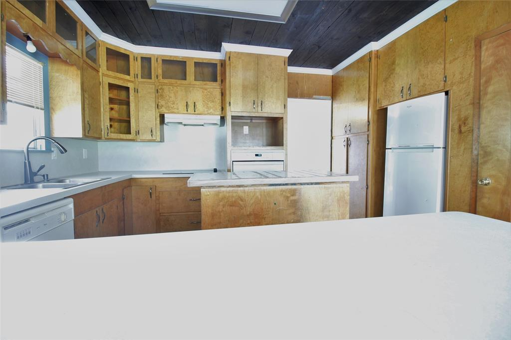 In the town of East Bernard this 2 story, 3 bedroom, 2 bathroom home on 0.4315 Acres with a Big metal Shop is ready for you!!!  Beautiful laminate floors, grey scheme throughout home and seller is building out a bedroom upstairs with a closet but this room can be used for whatever you'd like.  This home has so much potential!!!