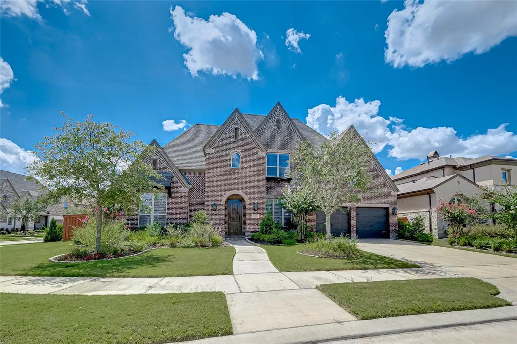 Stunning 2-story Highland home nestled in the heart of Aliana. Located just off the Grand Parkway and minutes from the Westpark Tollway. The home features 5 bedrooms all with en-suite bathrooms and both the master and guest bedroom are downstairs! In addition to the 5 bathrooms there are also 2 powder rooms, study, formal dining, game room, media room and open plan gourmet kitchen/breakfast/family area. The kitchen is well appointed with granite, double ovens and huge island. Additional upgrades include sweeping 2-story spiral staircase, outdoor swimming pool and kitchen, 3-car garage and gorgeous hardwood flooring downstairs. This master planned community is zoned to academically recognized Fort Bend ISD. Neighborhood amenities include 2 resort-style Clubhouses with swim centers, splash pad, 24-hour fitness centers, tennis courts, game center, ballroom, walking trails and lakes. Take a look at the professional photos and video tour to fully appreciate what this home has to offer.