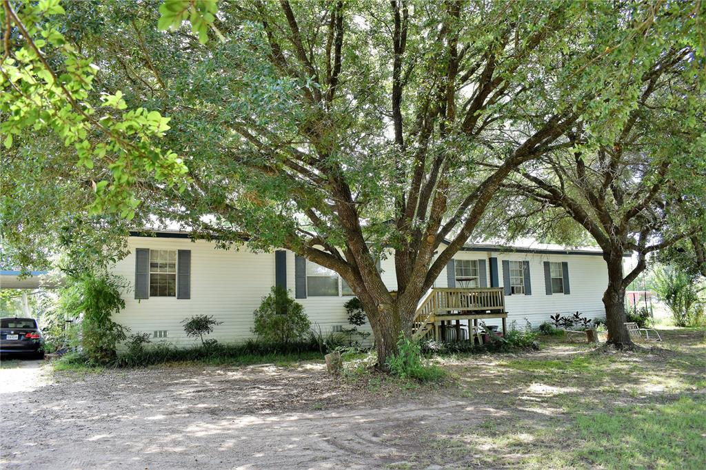 ****AUCTION***** 8/13-9/18****AMAZING Opportunity to Own this home! This property has been placed in an upcoming online event Welcome to your new home! Perfectly located 8+ acre unrestricted horse property on a quiet cul-de-sac in Cypress, TX less than a mile from the Grand Parkway. NO HOA, NO MUD, and very low TAXES! This property has everything! Starting with a 4 bedroom main house and a 3 bedroom guest house, both with brand new roofs and AC. Large garden offers self-sustainability. There are 2 barns. The main barn has a 30X13 tack room, cross tie chute, wash rack and 6 stalls with 3 attached run-ins. The second barn includes a tack room, 4 stalls, 2 including attached paddocks as well as tractor and hay storage areas. The property also includes a large, lighted dirt arena, grass running track and large swimming pond. Property is completely fenced as well as cross-fenced with 8 large pastures with run-in shelters. This is an income producing property. Open house Sept 14/15 10am-4pm