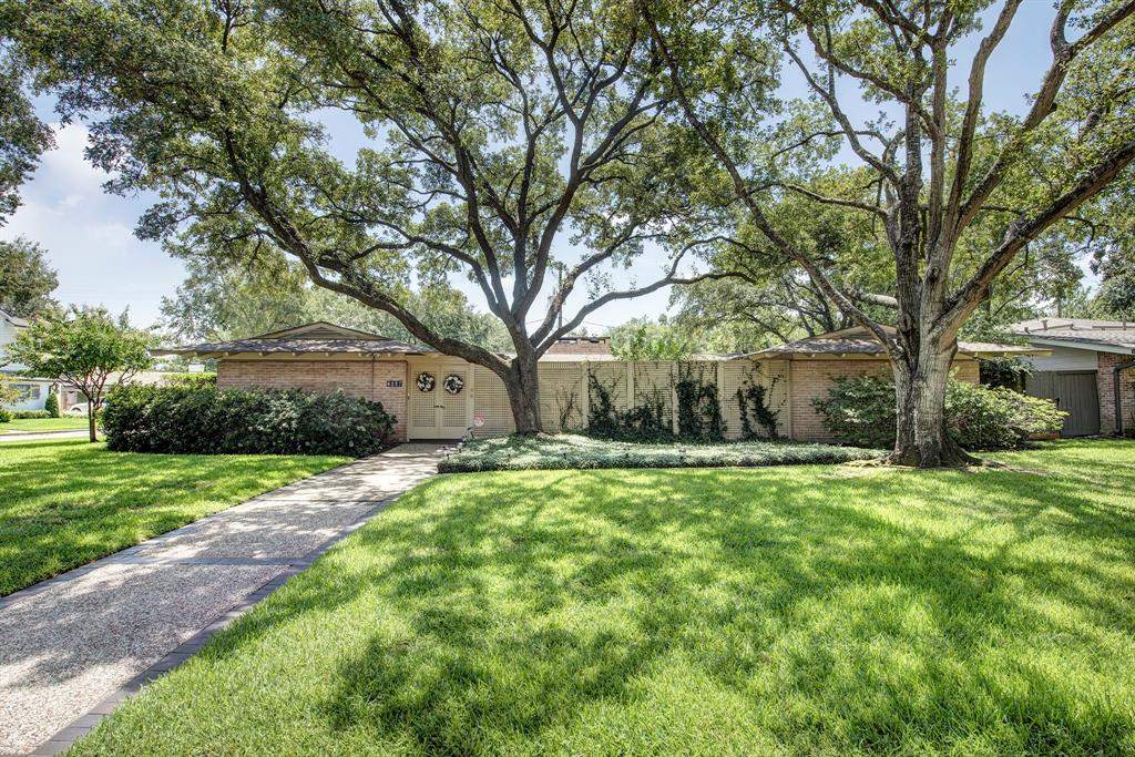 Awesome opportunity to live on a corner lot (11,520 sf per HCAD) in a mid Century modern home with two large courtyards. There is an abundance of natural light with glass windows all around. Kitchen and breakfast area have been updated* with granite and appliances. This property offers privacy and a low maintenance lifestyle. Large master bedroom and guest room plus a study, which could be a third bedroom. Master bath with walk-in marble shower and vanity. Exposed brick, built-ins, crown molding and wood floors. Extra room off garage in addition to a double carport. Wheelchair accessible. *per Seller