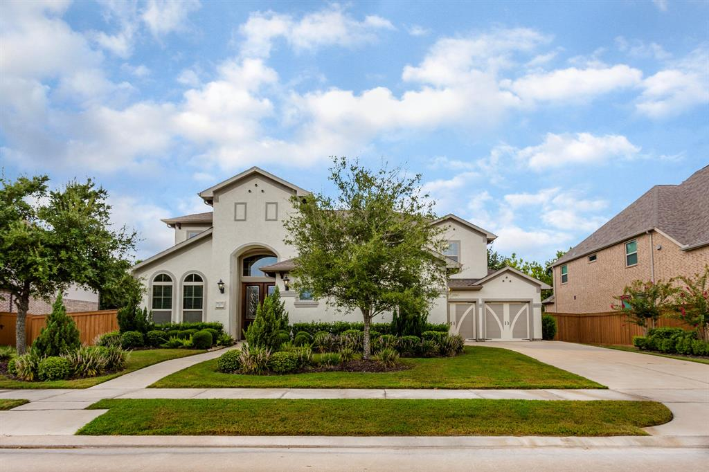 "Amazing 2 Story Coventry Built home is MOVE-IN READY!!  This 5 Bedroom, 4.5 Bath, 3 Car Split Garage is located in ALIANA on OVERSIZED LOT! Over $80K in BUILDER UPGRADES - List is Available!  Elegant Stucco on front and sides plus Stacked Stone wrap the entire back of the home!  White tile diagonally laid throughout is BEAUTIFUL! Double Entryway Front Doors!  The winding stairwell spirals up into MASSIVE 2nd floor Gameroom which opens to covered patio balcony!  Media room upstairs prewired with 5.1 for surround sound! Study downstairs with double doors leading into private room w high ceilings!  Gourmet Island Kitchen w Granite Countertops , Stainless Steel Appliances, 42"" Cabinetry! Open floor plan connects to a SPACIOUS family room!  HUGE Walk-In Pantry & Bumped Out Casual Dining Area!  Master Bath has Oversized Shower & Jacuzzi tub! LARGE Master Closet!  Sprinkler System & French Drain ! Backyard has Covered Patio w stub-outs for plumbing & gas!  Zoned to FBISD! MUST SEE TODAY!!!"