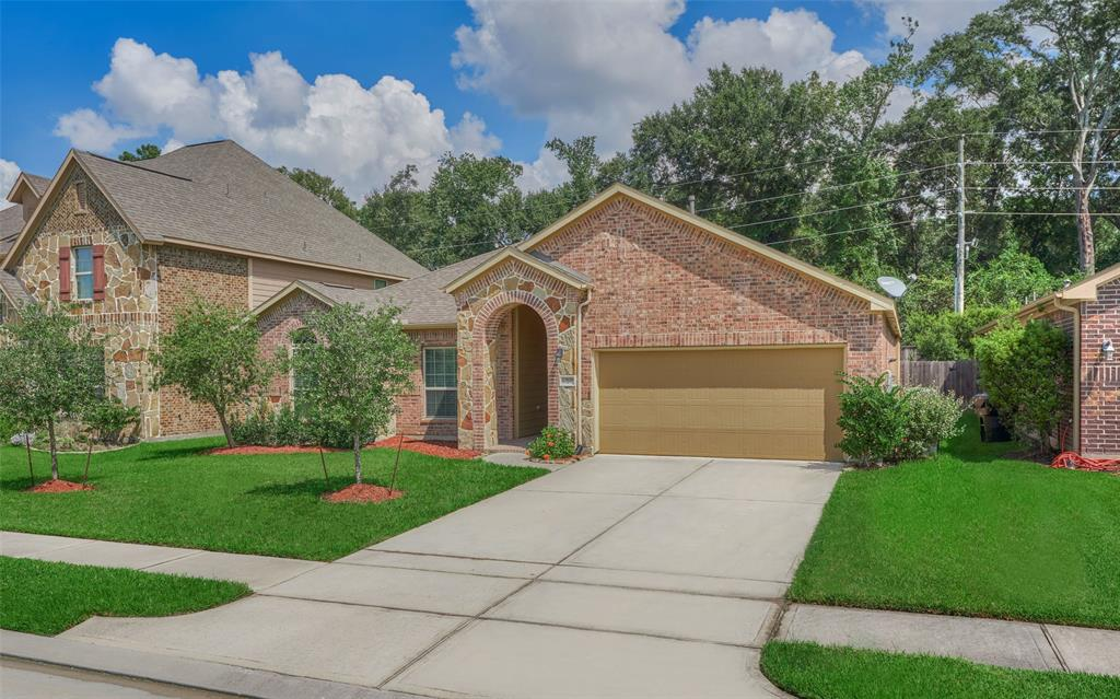 Don't miss this beautiful one story house located in a quiet gated community. Specious three bedrooms and two full bathrooms. Granite in kitchen w/stainless steel appliances, gas cook top, built in microwave & oven. Laminate floor in installed on 08/22. Dining room has wood floor. No Carpet.  Big backyard. Zone to high ranked KleinISD. Klein Oaks High school. Never Flooded.