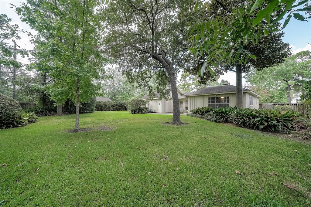 This home is situated on a lovely large wooded lot in Hedwig Village just a few blocks away from the Spring Branch Memorial Library and Hedwig Park. Home has good bones but needs a little TLC if to be lived in.  Excellent opportunity to buy and then build your dream home. Never flooded.