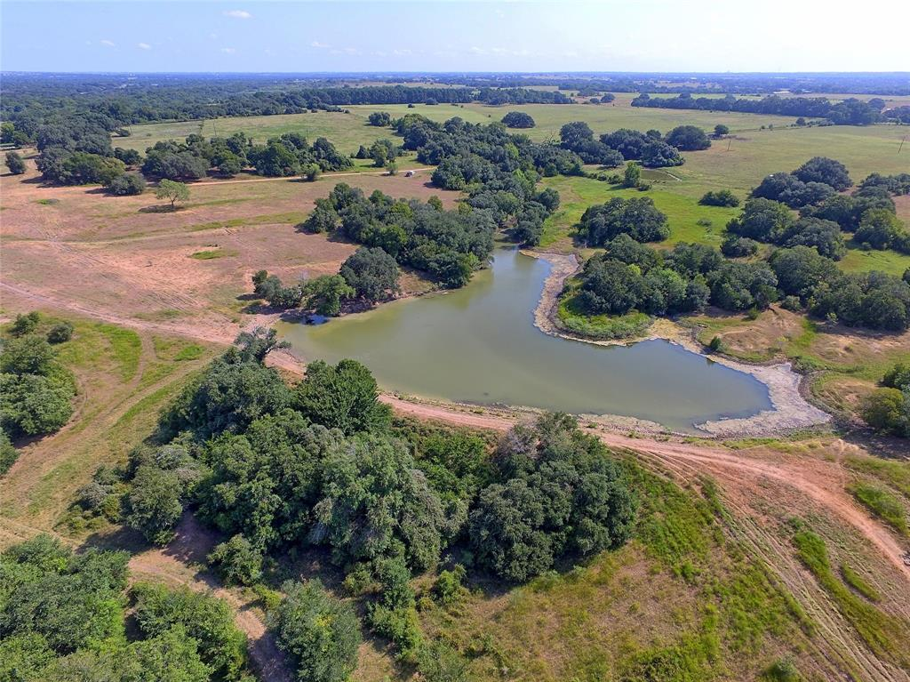 Located in Colorado & Fayette Counties just 10min south of Weimar I-10 Exit 682 off CR 250, this 381.734 acre recreational tract has an ideal home site with HILL-TOP view of the rolling countryside, pastureland for livestock grazing & wooded areas providing ideal wildlife habitat. The property features unmatched diversity highlighted by live East Navidad River establishing the west boundary, two ponds, 110' of elevation change, mature LIVE OAKS, cross-fencing, electricity & water well. A rustic barn could be restored or utilized for highly sought-after material for furniture projects. The property consists of mostly clay soils, is located within the Gulf Coast Aquifer, ag-exempt & situated within 1hr of BUC-EE'S in Katy or Bastrop. The property is accessed off paved CR 250 by a fee simple lane being approx. 35' wide x 1,500' long. No pipeline or oil/gas production affecting property. Survey available. This is a unique property where there's something for everyone to appreciate.