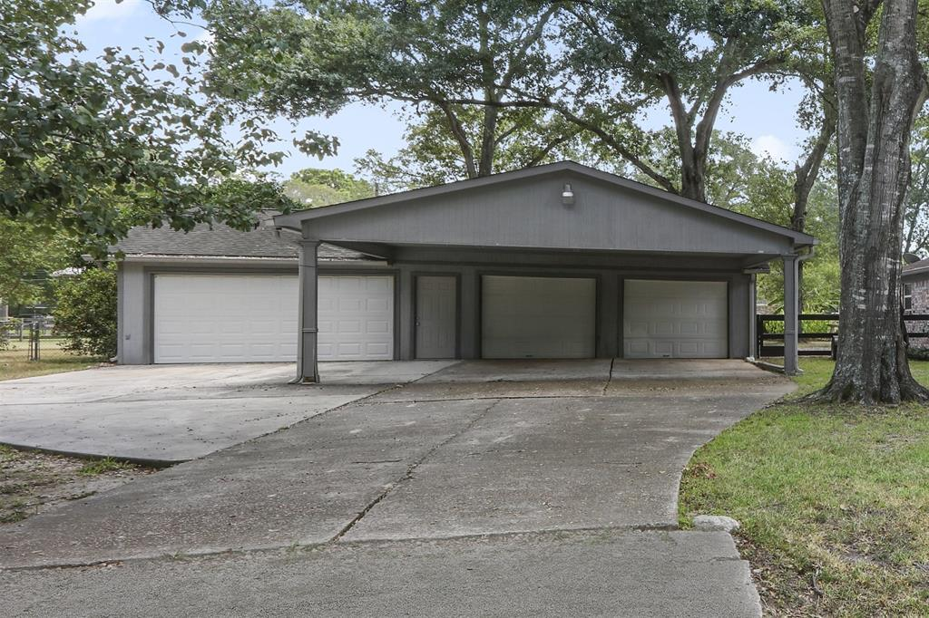 Four car garage includes additional large over-sized 2 car carport. It also includes built-in cabinets, a bathroom, and washer/dryer hook-ups (in-house utility washer/dryer hook-ups included as well).