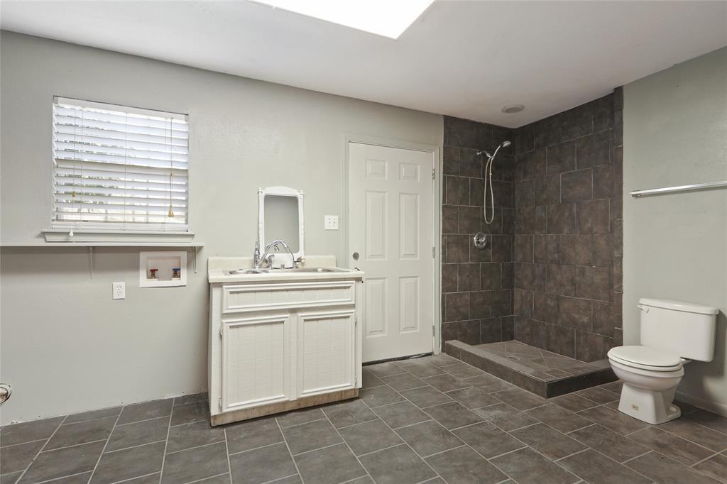 Bathroom located in garage.