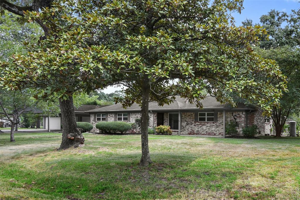 Ranch style home located on huge 33,960 square foot lot (HCAD) with a 4 car garage!