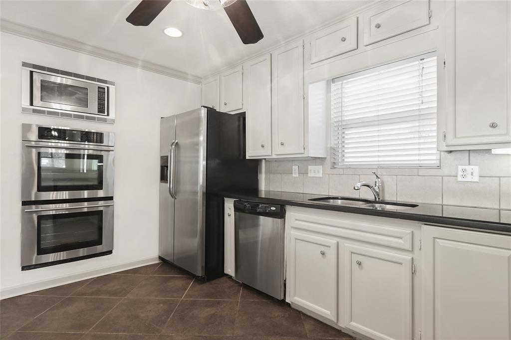 Stainless steel appliances include Double oven and built-in microwave. Refrigerator also included.
