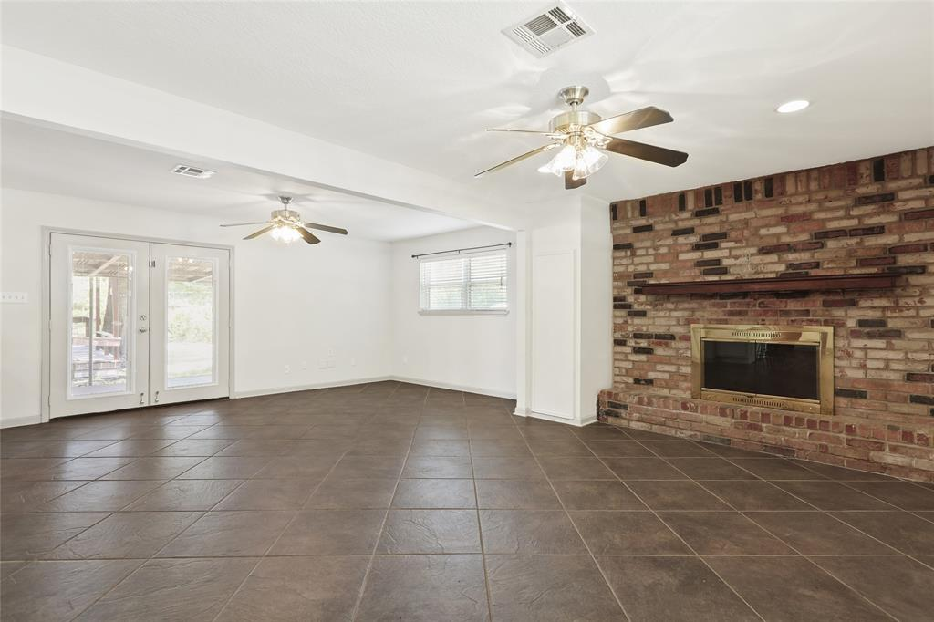 Living room also includes Wood burning fireplace.
