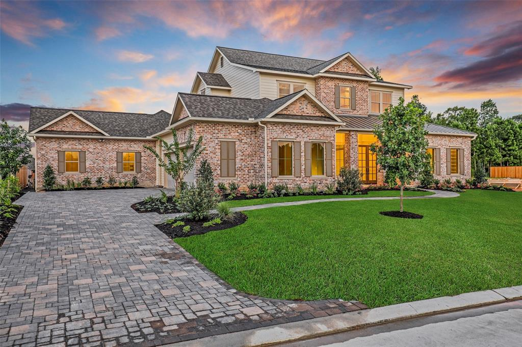 This meticulous custom home by by legendary builder, TD Cox Homes, exudes quintessential southern charm with quality craftsmanship. Behind the gates of Prosper, this is of the few available to purchase in the exclusive section of Stillwater. Lush landscape with authentic interior of the home. Enjoy hardwood floors complimented by polished wainscoting and exposed brick accent walls. From the fixtures to the architecture and rustic style that intertwine w/ a modern flare, no details were missed. Amenities include 1st floor guest bedroom, game room, private library w/ sliding glass barn doors, expansive chef's kitchen w/ high-end appliances, and a lavish master bath retreat w/ freestanding tub, dual closets, gorgeous vanities w/ makeup station. Outdoors, enjoy the elements of entertainment + leisure offering a modern pool & spa, covered outdoor pavilion w/ fireplace, summer kitchen, and lush greenery. Additionally, this home is zoned to TWHS!
