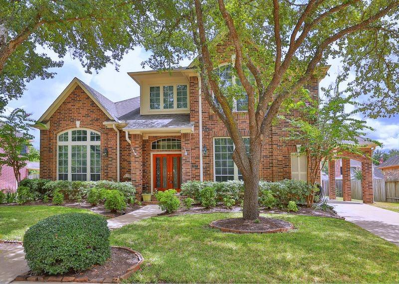 Gorgeous,UPDATED 5 bdrm,4 full bath,2 detached garage,porte cochere home is located in prestigious community New Territory. Home features 2 bdrm,2 full bath DOWN. Front foyer W/Soaring ceiling. NEW Hardwood floor,Crown molding in study,formal dining,living and master suite. Spacious formal living W/Double sided fireplace.Island kitchen opens to living equipped W/Granite counter-tops,New Built-in Stainless Steel  Oven, Microwave, Cooktop. Large formal dining W/Butler's pantry. OVER-SIZED Maser suite W/Fireplace,Bay windows,Frech door leads to backyard,huge walk-in closet. Master bath features duel vanities W/Granite counter-tops,NEW Frameless glass shower door/W Tile back-plash.Washer,dryer,Fridge stay! NEW water heaters. Elegant curved staircase W/Hardwood floor. Ample game-room W/three bdrm,walk-in closets,2 full bath on the 2nd floor. Extra parking W/Porte Cohere is a PLUS. House HAS NEVER BEEN FLOODED!