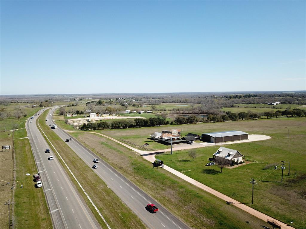 Prime opportunity to own apx 200 ft. of premier HW 290 road frontage along with an awesome Hill Country style office/cabin, just outside of popular Chappell Hill, Tx. Being 55 miles to Houston and 90 to Austin the business opportunities and growth are endless. Well and septic are in place, 2 AC units, W/D hook-ups, shower and kitchenet. Everything you need plus a front and back porch to relax on after a long days work! Additional acreage is avaliable as follows. 14.315 acres with the house/office building for $749,000 9.00 acres with the house/office building for $699,000 The back 11.815 acres no improvements for $249,000 Cut out 5 acres with Hwy 290 entrance for $179,000