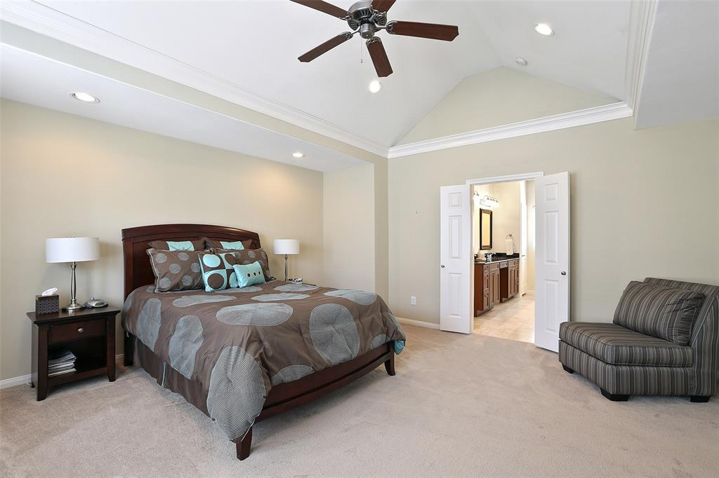 This large master suite includes a vaulted ceiling, recessed lighting, and plenty of space for an additional sitting/reading area. Per the seller, the carpet has been recently replaced.