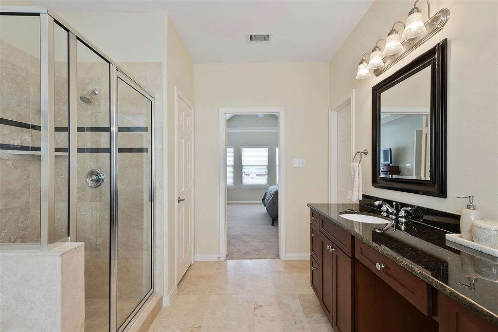 You're going to love the dual vanity with granite counter-tops and the beautiful tiled floors.