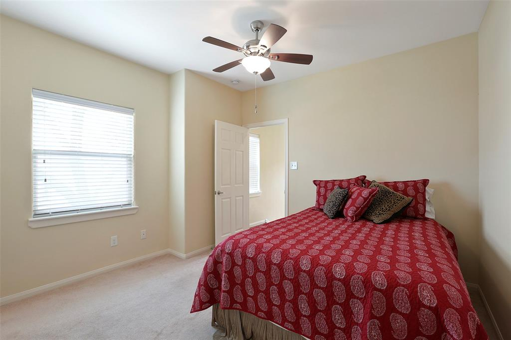 This generous secondary bedroom is located on the floor with the master suite. You will also find a utility room on this floor.