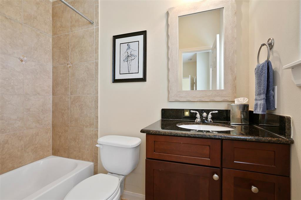 The en suite is located just off the upstairs guest bedroom. Like the 1st floor bathroom (yes, that is 3 full bathroom and 1 half bath), the bathroom includes a granite topped vanity with plenty of storage.
