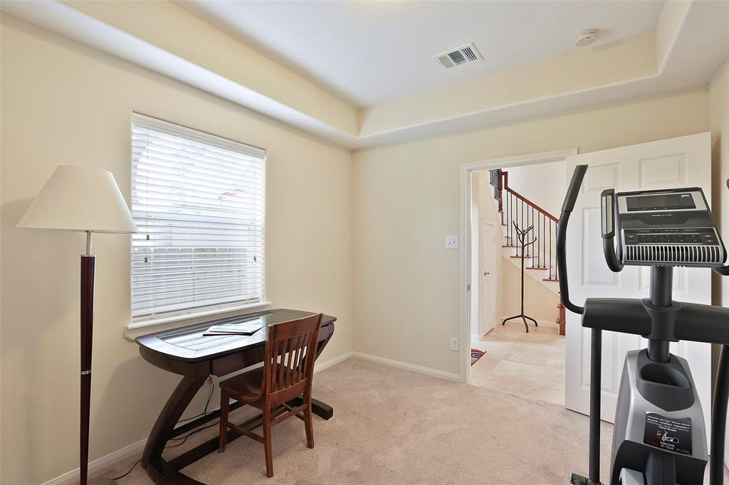 Located on this first floor, this bedroom provides a lot of versatility. It offers plenty of space as a guest bedroom. However, it can also double as a study, workout room, or craft room.