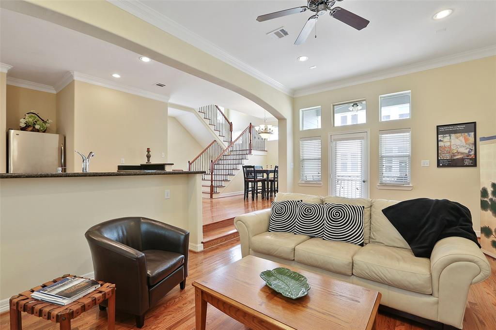 This large, dramatic living space provides a great space to entertain and relax. You're going to love the hardwood floors and recessed lighting.