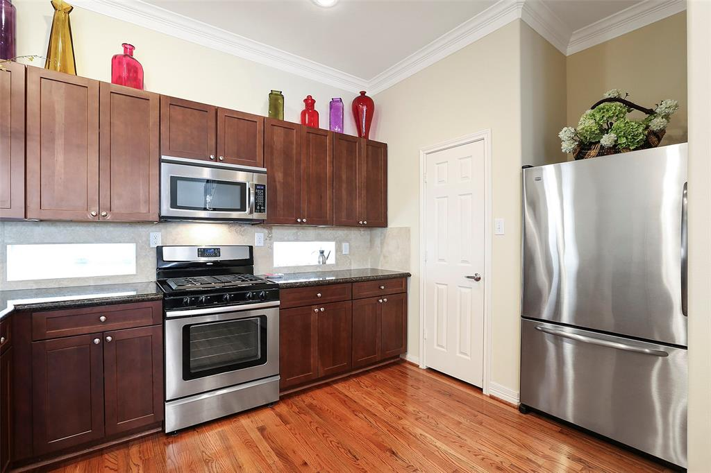 The under cabinet windows provides additional natural light into the kitchen and helps to open up the kitchen space. Stainless steel refrigerator is included.