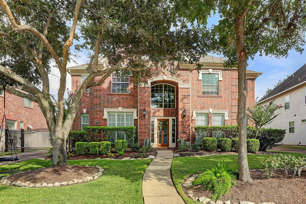 Gorgeous Newmark home with backyard oasis including heated pool and spa. This lovely updated home features a double height entry and family room, 4 bedrooms and 3.5 bathrooms. Downstairs master has relaxing views off the sparkling pool and spa. Large master bath recently updated and has 3 closets! Upstairs has 3 bedrooms, 2 baths and game room. Additional features include plantation shutters, built ins, wood floors, beautiful light fixtures and ceiling fans. The kitchen features stainless steel appliances including a gas cook top, and island, painted cabinets and granite counter tops. Buyers will appreciate the extra large storage in large laundry room and over-sized 2 car detached garage. Some updates include new upstairs A/C in 2019, water heaters, digital learning thermostats, carpet, interior paint and pool resurfaced in 2018. Greatwood is conveniently located to Hwy 59, Hwy 99,  shopping, restaurants, and entertainment!