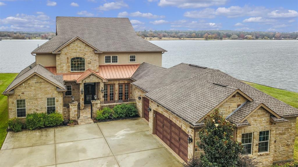 Incredible OPEN WATER, Custom home located in the gated community of French Quarter on Lake Conroe. This home has all the bells & whistles you have been searching for. The main home + casita offer 4/5 Bdrm, 5.5 baths and 3 car garage w/Epoxy Flooring. (Full bath in garage) The home is appointed w/travertine flooring throughout the lower level w/carpet in bdrms. Master Suite is down along w/granite island kitchen w/double ovens, pot filler, 6 burner Kitchen Aid gas stove, central vac, ADA capable, bug system, huge laundry room, walk-in pantry w/pull out drawers & built-in's, extensive mill work & custom cabinets, covered porch w/ outdoor kitchen & Isokern fireplace, gas lanterns, generator, elevator, media room w/wet bar, an office that could be a bdrm & 2 bdrm & 2 full baths. The attic will take you to a cedar lined closet for additional storage. Brand new bulkhead ($25K value). Covered boat slip w/lift, jet ski lift. Must see! WISD.