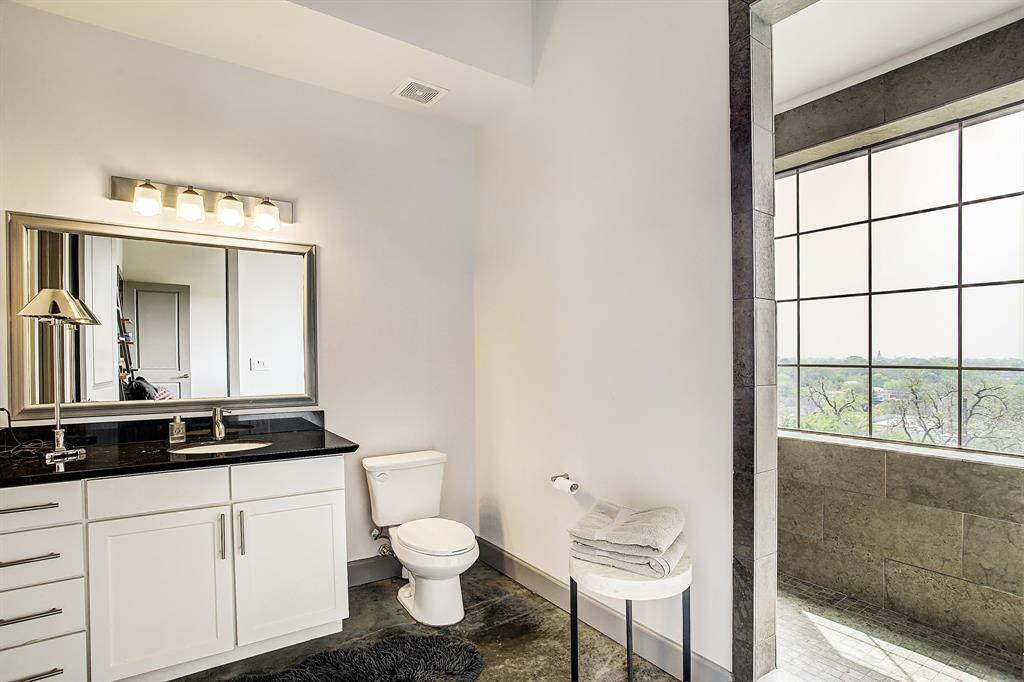 The secondary, en-suite bath, also with a walk-in shower stall and amazing natural light. There is complete privacy here, no other properties come close to the height of this 6th floor, penthouse level condo.