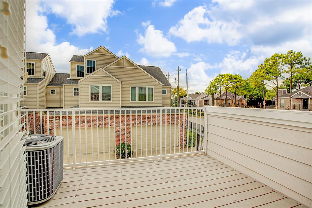 The deck off of the master bedroom, which sits over the garage.  The street to the right is Piping Rock.