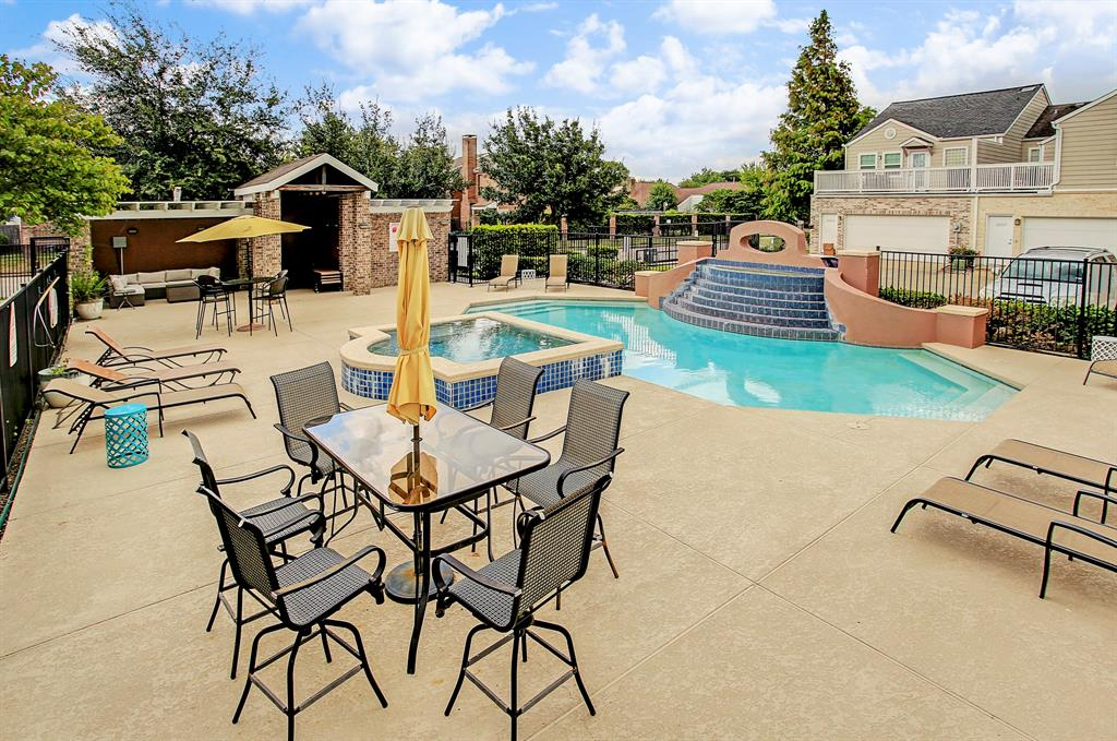 The community pool offers a wonderful place to cool off, or enjoy coffee or wine!