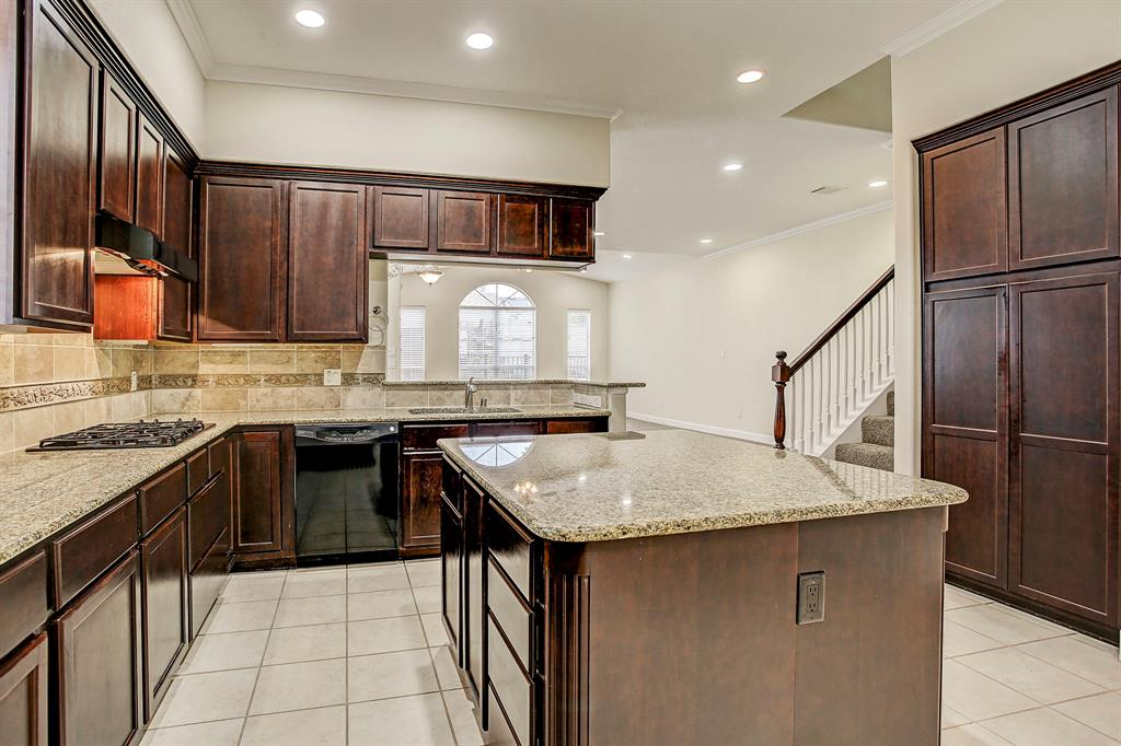 This kitchen has so much counter and cabinet space.  To the right outside the photo is the utility closet with washer and dryer, a half bath and fabulous under stair storage space.