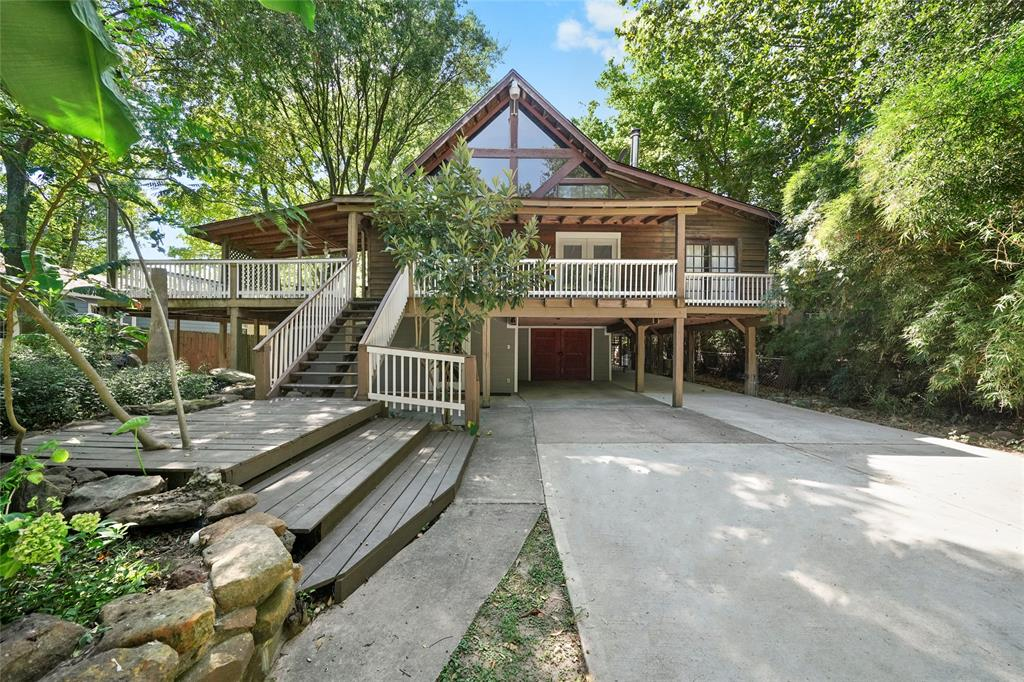 Unique rustic lakefront property just outside The Woodlands. Zoned to The Woodlands schools and with quick and easy access to I-45, area hospitals and all the amenities of The Woodlands! Peaceful lake views from the spacious deck area! Enjoy the tranquility of the lake and the wooded surroundings. Extensive storage and parking areas on the ground level. Remodeled in 1996. Total of 5 bedrooms with two living areas and two kitchens. Perfect for large or multi-generational families.