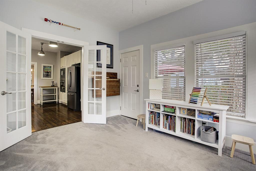 French doors to the den from the kitchen can be left open, or closed to create a quiet office or even guest space.