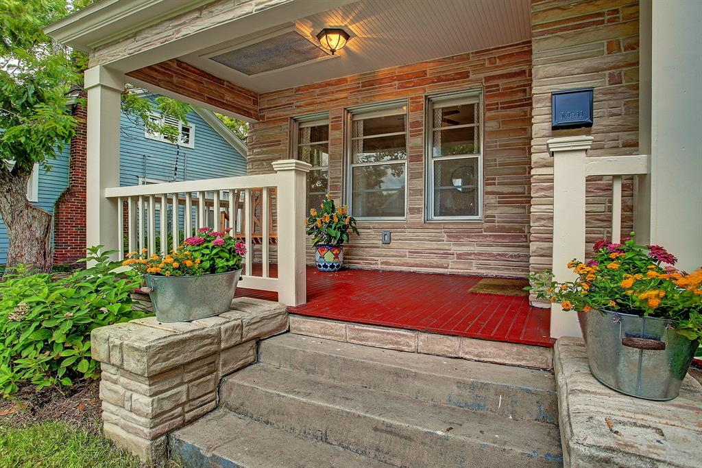 The spacious front porch readily accommodates a few rocking chairs or other comfortable furniture.