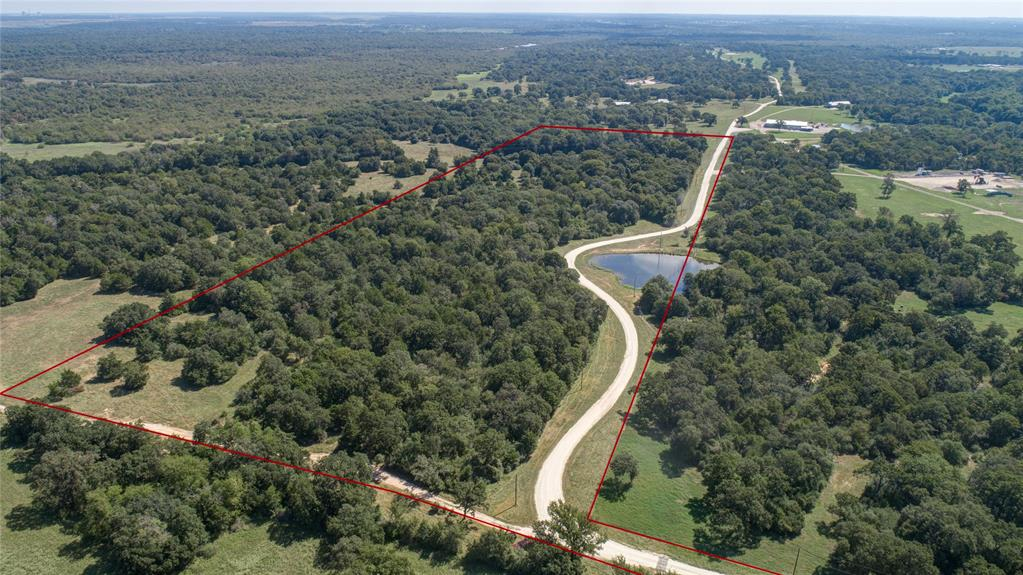 "Rare find! 35.87 acre tract in south Brazos County off Hwy 6 just 15 minutes from Texas A&M University. This unrestricted tract offers many possibilities including a weekend getaway, permanent home site, or even a commercial business location. With Hwy 6 frontage the property is easily accessible and lends itself to many uses. The rectangular shaped land includes a nice stock tank, rolling topography, 6"" Wellborn Water line near the front, and 18"" along the TXDOT right of way. Heavily wooded with large Post Oaks create the beginnings of what could be a real show place. Additional acreage is also available."