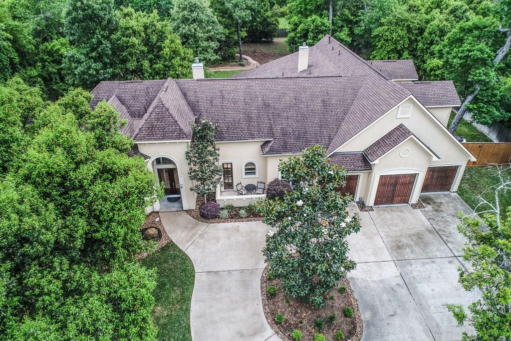 A very BEAUTIFUL home on a quiet cul-de-sac. Open kitchen, lg family room, a sun room, an amazing entry w/rotunda, private study, formal dining with a dual sided fireplace, master down w/patio access, 2 bdrms down with a shared bath, a 1st floor gameroom that can be used as a 1st floor guest suite, a play room, a mud room off the garage, and an outdoor gazebo. Private 2nd floor with an entrance near the mud room. There are 2 bdrms, a jack-n-jill bath, an exercise room w/kitchenette, a  media room with soundproofing and an in-law or nanny suite wired and plumbed for a kitchenette that includes a full bathroom and walk in closet. Perfect for guests, a live in helper, a college age person or a 2nd family. The 2nd floor is very private. Updated carpet and paint. Situated on over an acre with no backing neighbors due to green space. Estate living at it's finest with full community activities included in Bender Landing Estates. Lakes, trails, a large club house and much more.