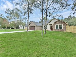 Beautiful Brick & Stone Custom Home Perfectly Situated on a Half Acre Lot in the Established Piney Point Subdivision, Conveniently Located off Loop 336E & 3083.