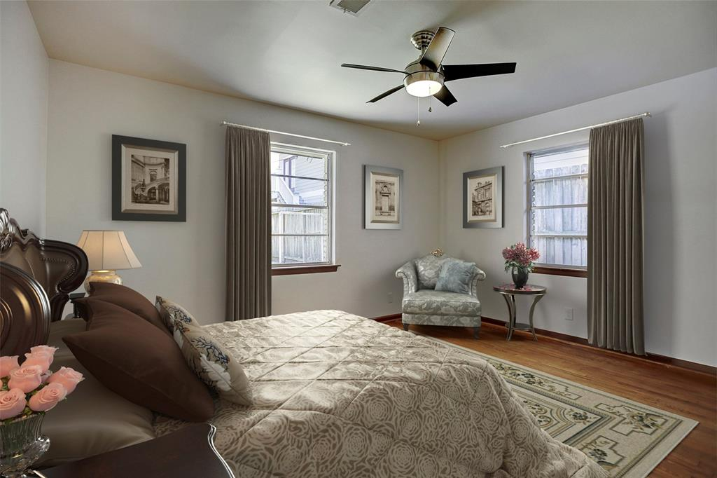 The third of three bedrooms sits at the back of the home and looks out on the beautiful big back yard. The half bath is located within this bedroom. This space has been virtually staged.