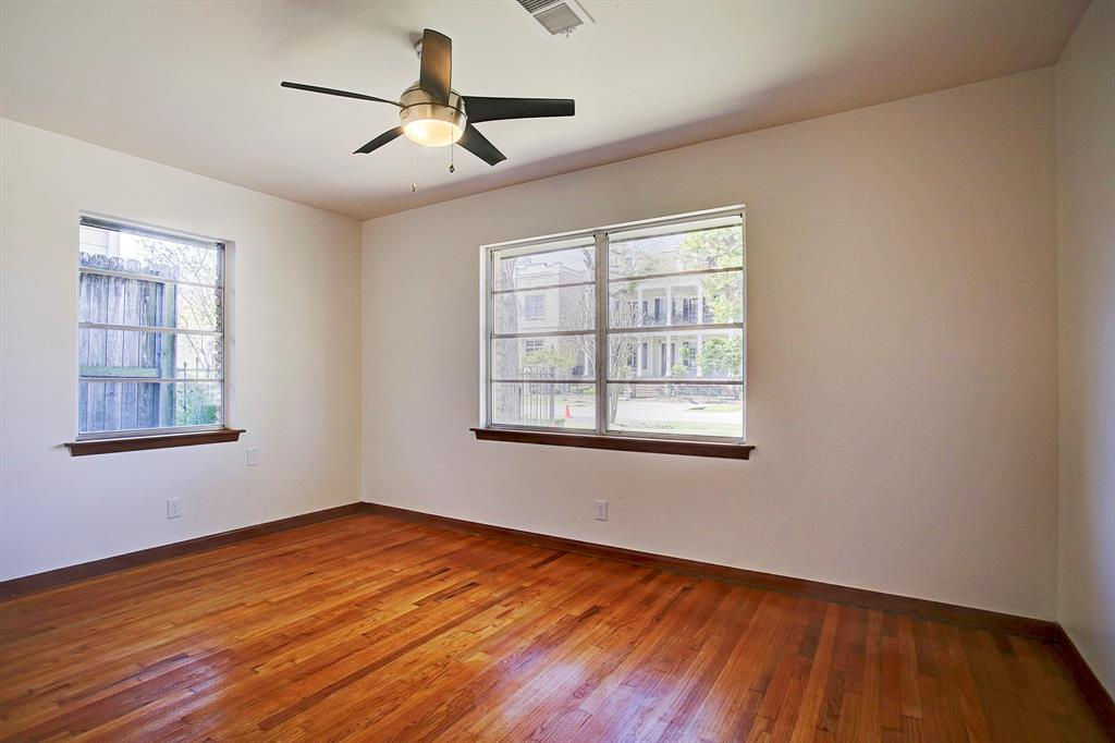 The first of 3 bedrooms, this one overlooks the freshly landscaped and custom lighted front yard.