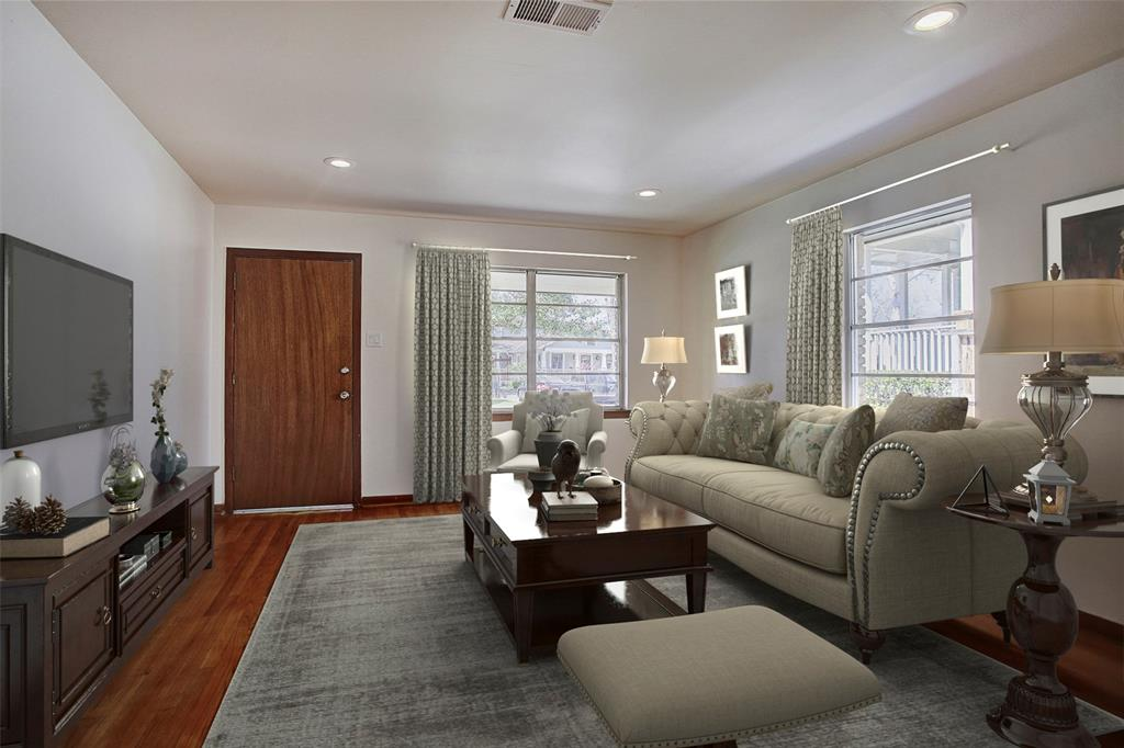 Enter this charming home into a spacious living room filled with light. This room has been virtually staged.