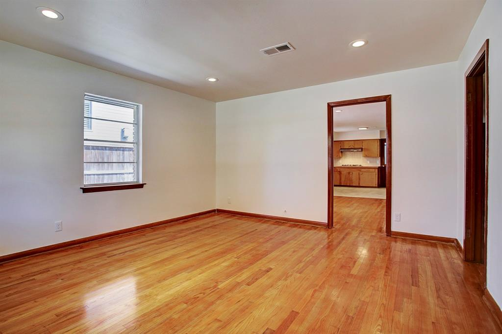 The living room offers a space separate from the kitchen and dining room/2nd living space, to watch TV, read or study. The door to the right leads to the hallway, bedrooms and full bath.